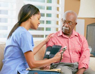 nurse getting senior man's blood pressure data