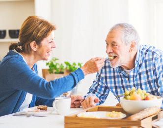 wife helping her husband eat