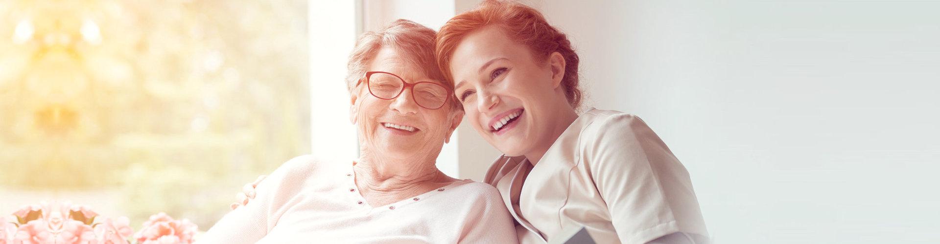 happy caregiver and senior woman