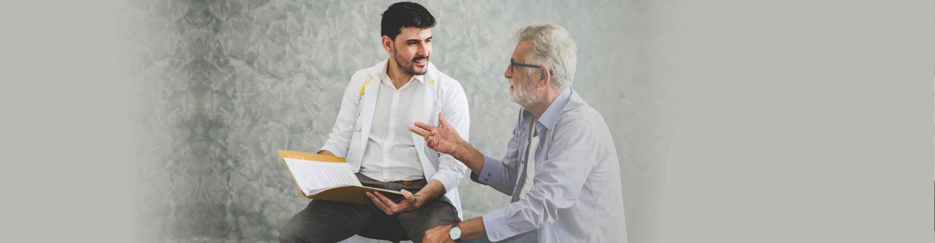 senior man talking to an expert