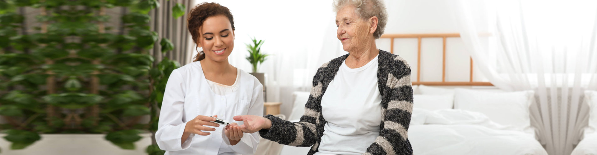 caregiver getting senior woman's blood count