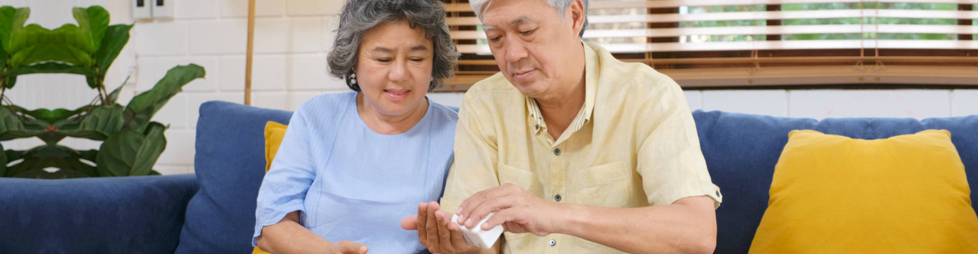 husband giving medication to his wife